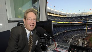 In this Sept. 25, 2009, file photo, New York Yankees broadcaster John Sterling sits in the booth before the Yankees' baseball game
