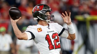 Tampa Bay Buccaneers quarterback Tom Brady (12) throws a pass against the Dallas Cowboys during the first half of an NFL football game Thursday, Sept. 9, 2021, in Tampa, Fla.