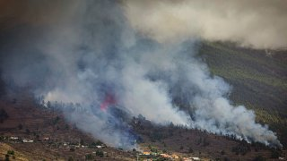 Smoke rises at the Cumbre Viegja volcanic on the island of La Palma in the Canaries, Spain