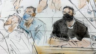 This sketch shows defendants Salah Abdeslam, right, and Mohammed Abrini in the special courtroom built for the 2015 attacks trial, Sept. 8, 2021 in Paris.