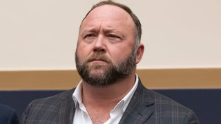 FILE - This Tuesday, Dec. 11, 2018 file photo shows radio show host and conspiracy theorist Alex Jones at Capitol Hill in Washington. On Thursday, April 9, 2020, the U.S. Food and Drug Administration sent a warning letter ordering Jones to stop falsely claiming that toothpaste, mouth wash and other products sponsored by his show can help prevent COVID-19.