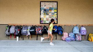 A student rushes to her classroom for the first day of class.