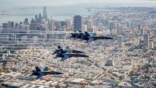 The US Navy Blue Angels fly over San Francisco.