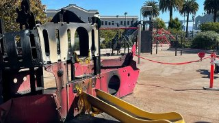 The fire-damaged children's play area of Sue Bierman Park.