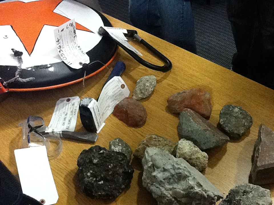 These are some items police picked up during Wednesday night's clash in Oakland, Calif., including a shield, sledge hammer and rocks. About 7,500 protesters participated in a general strike and shut d