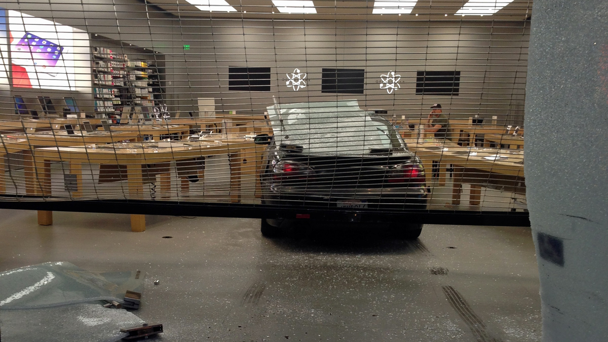 A suspect drove through the glass windows of the Apple store in  Berkeley early Friday morning, May 9, 2014, and made off with store merchandise, police said.