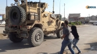 Residents of Northeast Syria City Pelt Departing US Troops