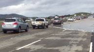 Flooded northbound Highway 101 is reduced to one lane
