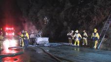 Vehicle Fire Ignites Steep Hillside, Blaze Extinguished