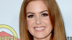 Isla Fisher Takes A Bite Out Of