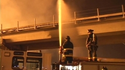 Raw Video: Fire Burning Near West Oakland BART Stop