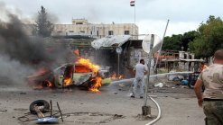 Scores Killed in Multiple Blasts in Syrian Government Strongholds