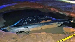 Alleged Drunk Nearly Drowns in Sinkhole After Hydrant Crash