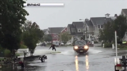 Man Surfs Down Street in New Jersey