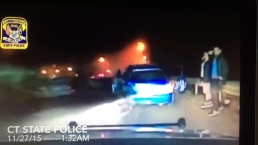 Car Narrowly Misses Stranded Drivers