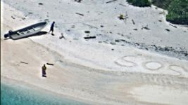 Boaters Rescued After Writing 'SOS' in Sand