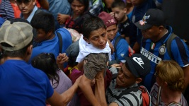 Migrants Break Guatemala Border Fence, Rush Toward Mexico