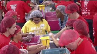 Volunteers to Honor 9/11 Victims, Pack Meals for the Hungry