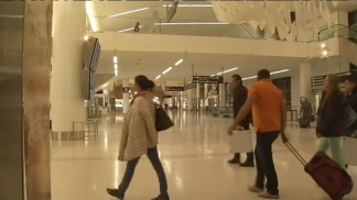 Travelers Stranded by Sandy Camp Out at SFO