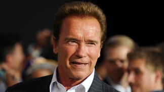 Arnold Schwarzenegger Competes with Co-Stars for Best Body