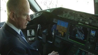 Governor Talks Taxes and Tours Dreamliner