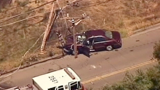 Man Pulls Woman From Car in Power Pole Crash