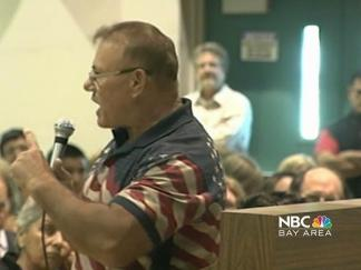 Emotional Meeting Pits Patriotism Against Political Correctness