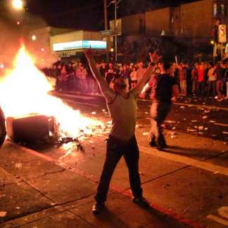 Fans Flood Streets, Light Fires Sunday Night