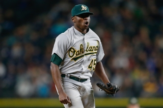 A's Rally in Extras, Eliminate Mariners