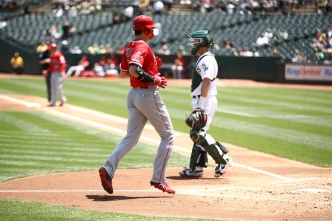 A's Rally Twice, Lose to Angels in Extra Innings