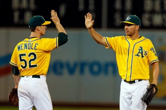 Rookie Caps Eighth-Inning Rally to Lift A's Over Angels