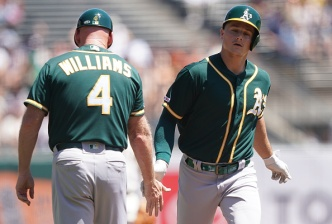 Chapman Homers Twice to Lead A's Past Giants