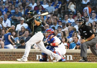 A's Late Rally Falls Short in Loss to Cubs