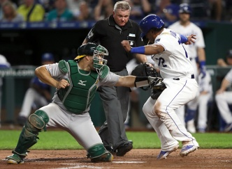 Fiers and Company Lead Way as A's Edge Royals