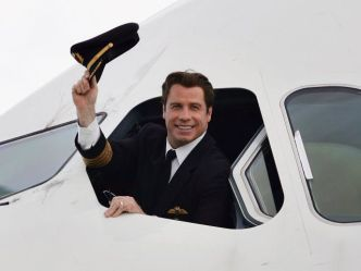 Top Gun: Travolta Piloting Aid to Haiti