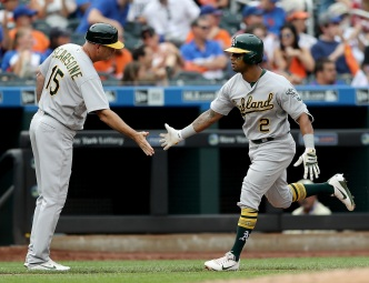 A's Use Three Solo Shots to Avoid Sweep Against Mets