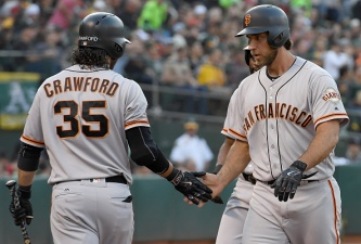 A's Roll Past Giants to Set Up Possible Sweep