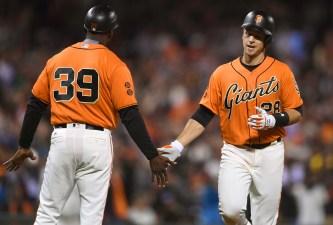 Giants' Bats Stay Hot, Moore Tames Cardinals