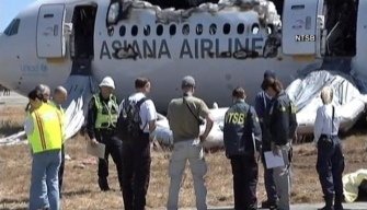 NTSB: Asiana Pilot Told Passengers Not to Evacuate