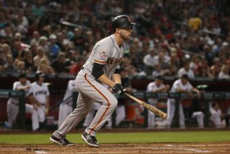 Suarez, Slater Lead Giants to Win in Road Trip Opener