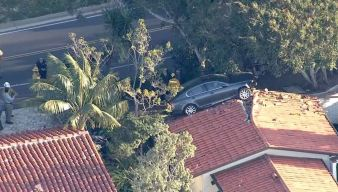 Car Crashes Onto Roof in Southern California