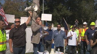 Construction Trade Workers March, Demand Better Wages from Developer