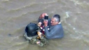 Elderly Man Rescued from Turbulent Flood Waters