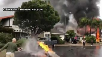 Neighborhood Grieves Loss of Lives When Disintegrating Plane Crashed on House