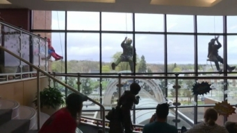 Superheroes Wash Windows at Minnesota Children's Hospital