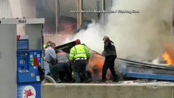Gas Station Structure Collapses on Firefighter