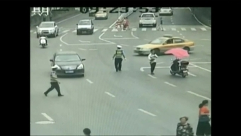 Toddler Rescued From Oncoming Traffic in China