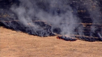 RAW VIDEO: Crew Battles Grass Fire Near Eastridge Mall