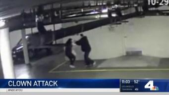 Surveillance Video Shows Man in Clown Mask Robbing Woman