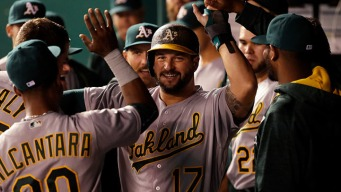 Clutch-Hitting A's Rally to Beat Royals